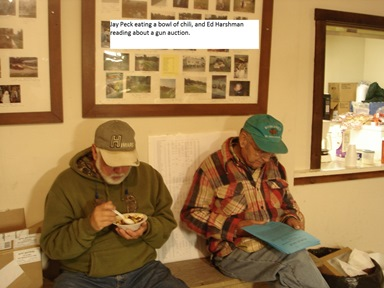 Jay Peck eating a bowl of chili, and Ed Harshman reading about a gun auction